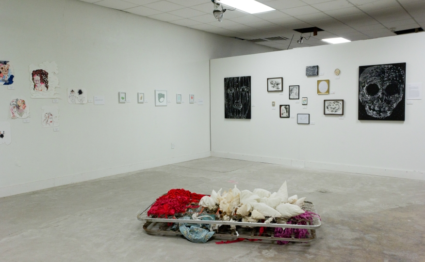 Installation shot shown with the work of John Cody Williams (left wall) and Vanessa Garcia (ground)